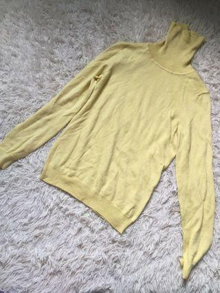 Soft yellow turtle neck knitted top
