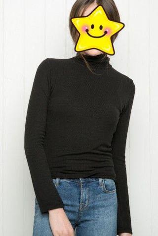 Black turtle neck knitted top