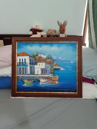 Painting of house by the sea