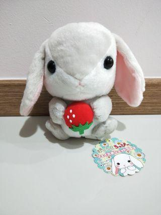 Bunny with a strawberry plush