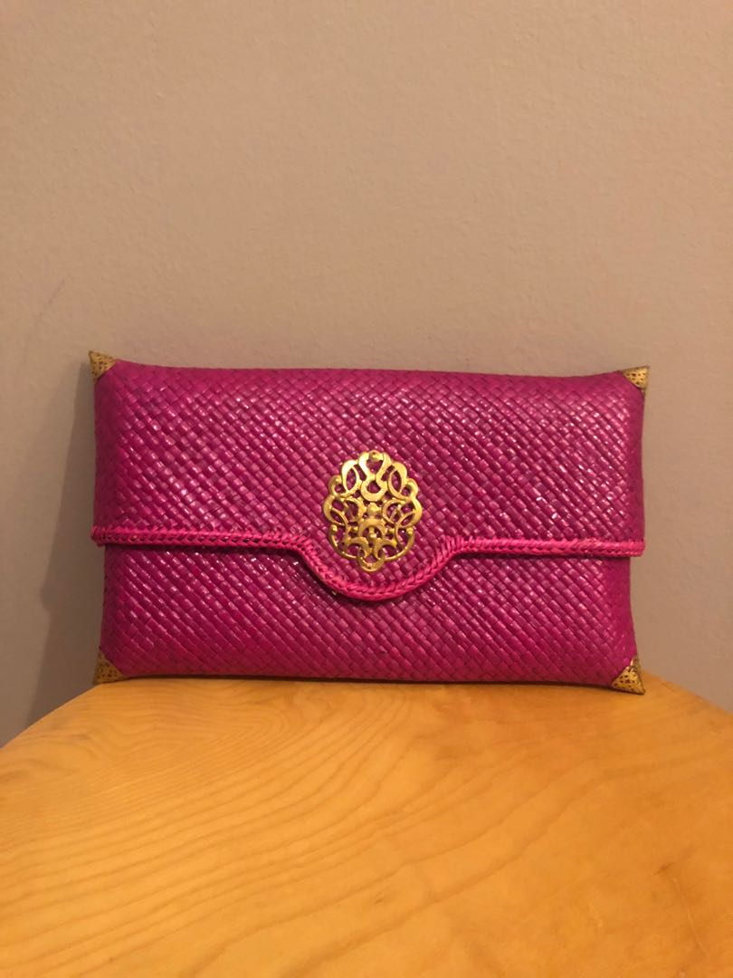 Fuchsia pink woven clutch bag with kerongsang detail (traditional look)