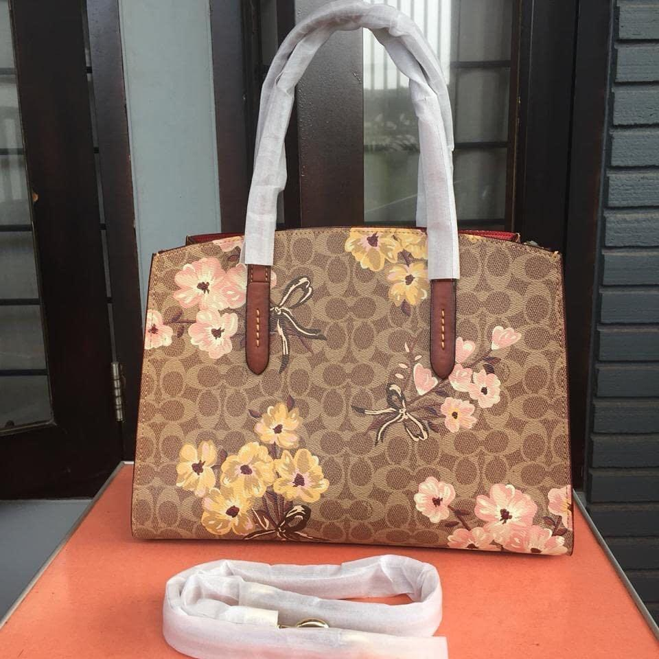 Coach Carlie Carryal in Signature With Prairie Floral print Authentic with serial number NEW