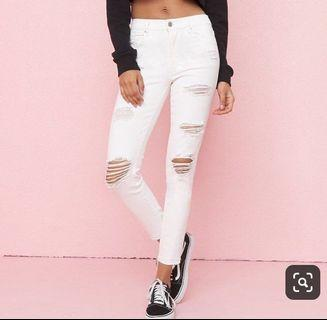 White ripped garage jeans