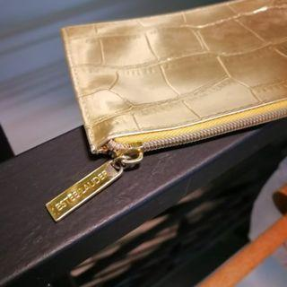 Authentic Estee Lauder gold make up pouch.