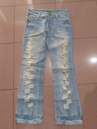 Ripped denim with glitter details