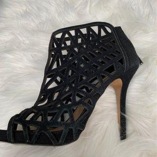 Caged black heels