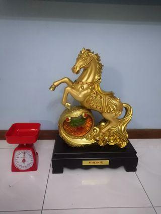 Golden horse statue with stand base