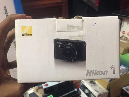 Nikon 1 J1 Digital Camera + 10-30mm lens + 10mm/2.8 lens + 8GB SD Card #OYOHOTEL