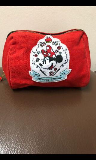UNIQLO x Disney limited edition Minnie Mouse Pouch . Used about twice . 15cm x 11cm .Excellent condition . No defect
