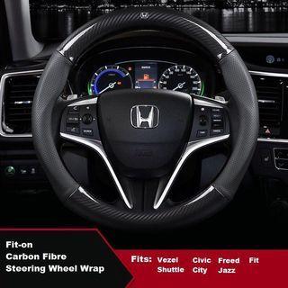Carbon design steering wheel cover.