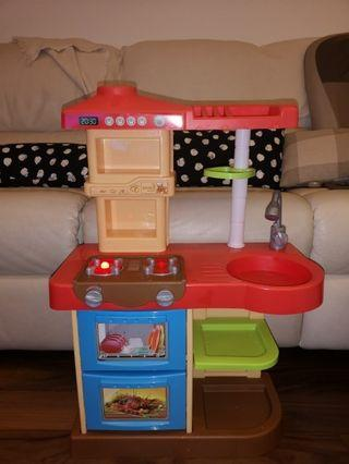 Toy Kitchen 90%new, with sink,oven ,space for stowing plates( plates not included) ,pretend play. Not heavy but safe to play