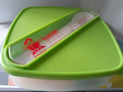New lunch box with spoon provided