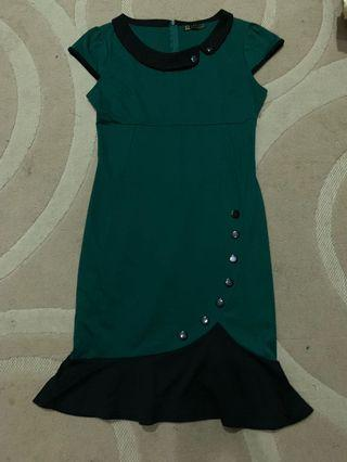 Green Dress with black accent details