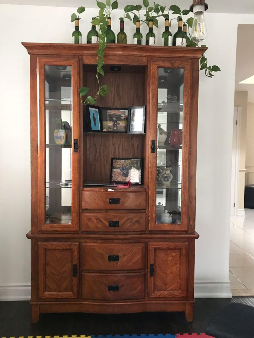 Solid wood hutch and buffet with lights inside, Ashley 2 years old
