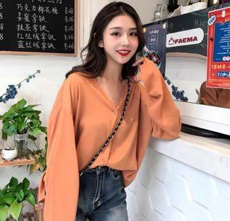 orange v neck button down long sleeve top
