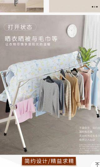 🚚 Brand new expandable roller Clothes Drying Rack 1.6m