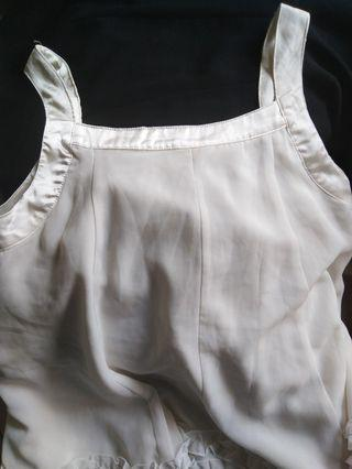 White ruffled top
