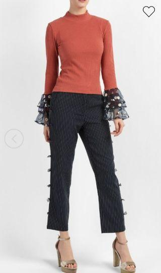 Fashion Valet Turtleneck Top with Ruffle Cuffs in Rust Red