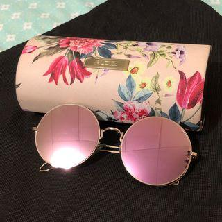 Sunglasses and floral case