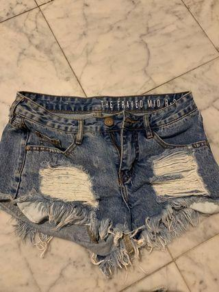 Blue mid rise ripped denim shorts XS