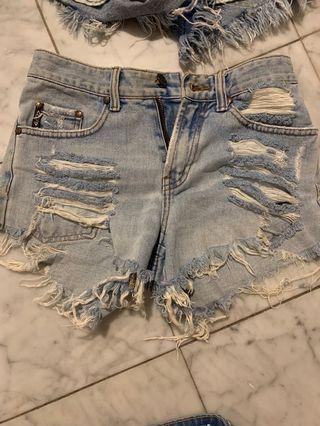 Very ripped worn high rise denim shorts size 6-8