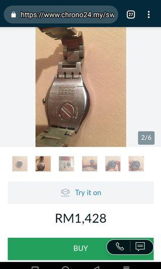 Jam tangan jenama swatch irony patented
