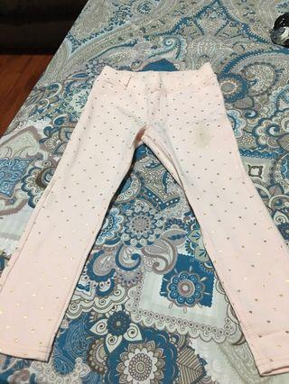 Pink pants with gold dots