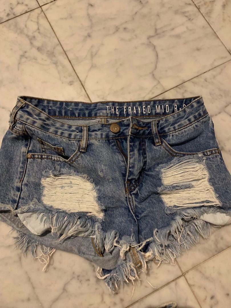 Blue mid rise ripped denim shorts XS