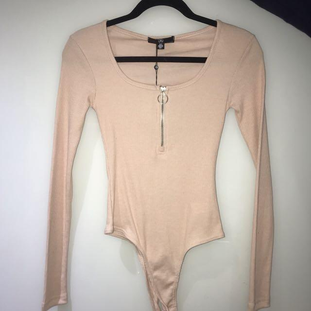 Missguided baby pink zip front long sleeve bodysuit