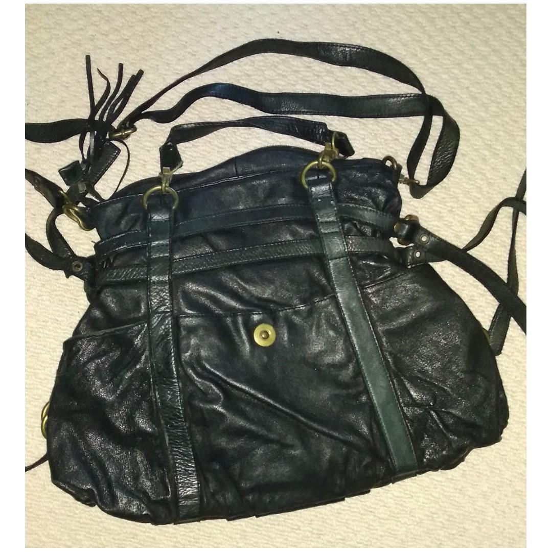 Steve madden leather black hand bag with brass strap details