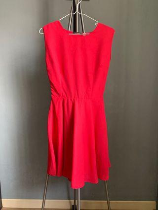 Red dress with scallop opening at the back