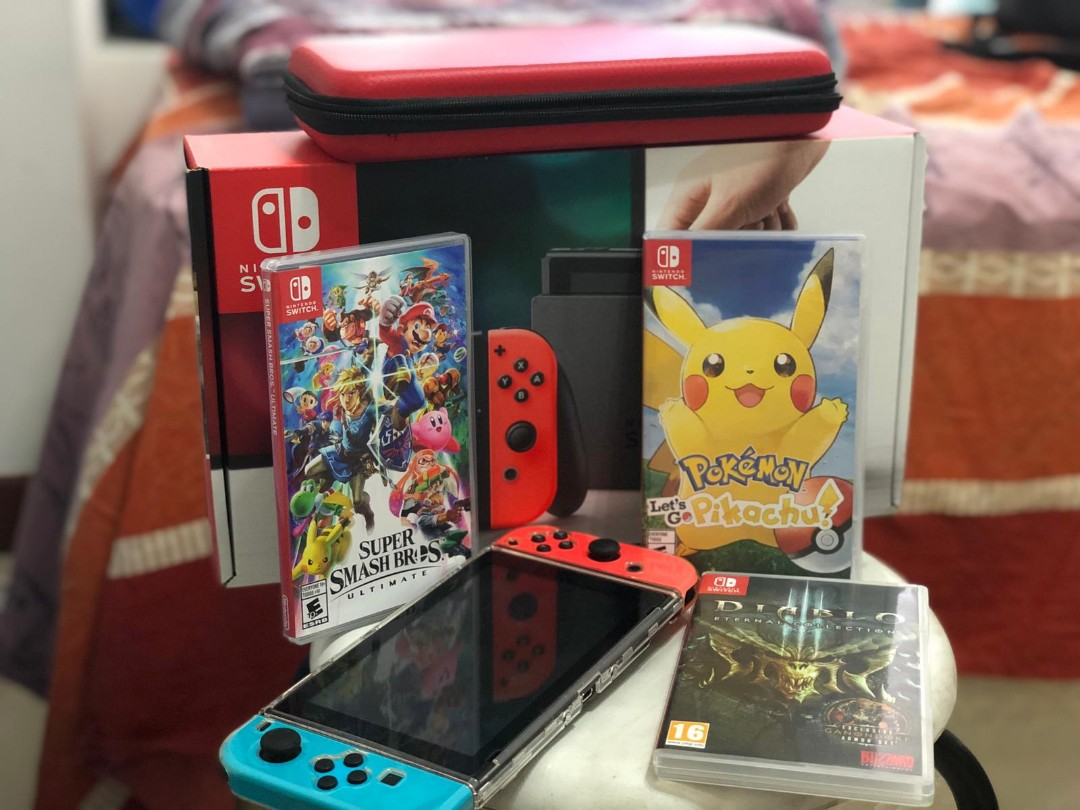 Nintendo Switch !!! With Warranty and Three Games !! Local Set !! With Niko  Case !!