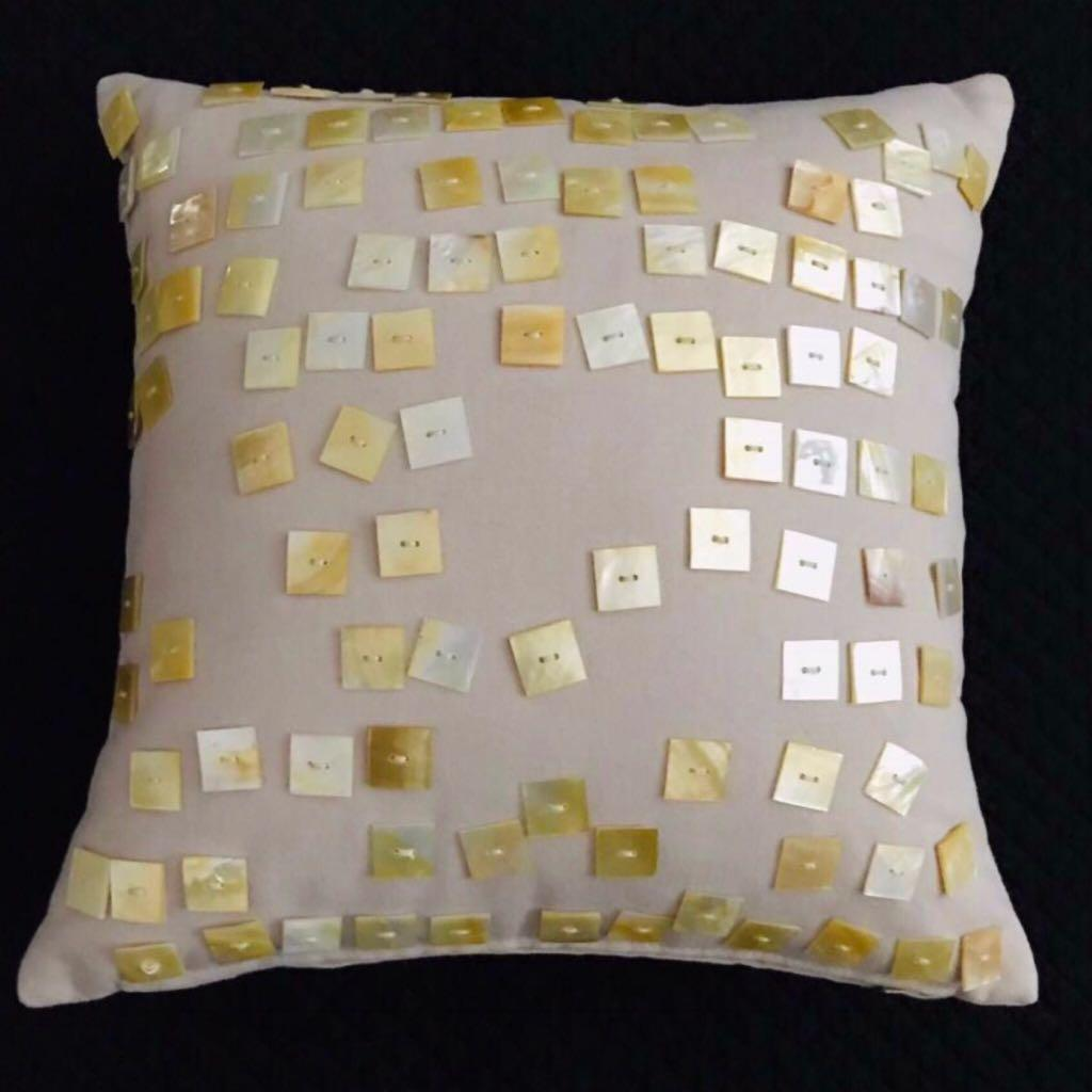 Square cushion with pearl shell button embellishments