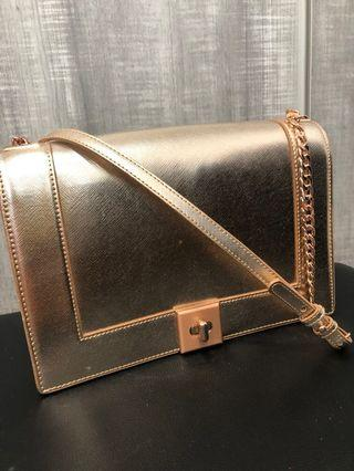 Was $89. Like new Charles and Keith Rose gold sling bag