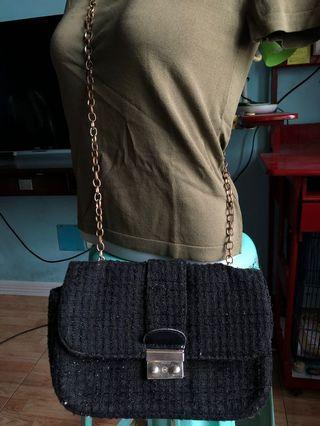 Black sling bag with gold sling
