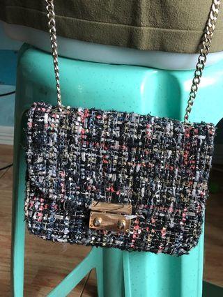 Sling bag with gold sling