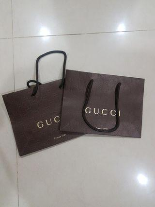 Free delivery: Gucci small paper bag