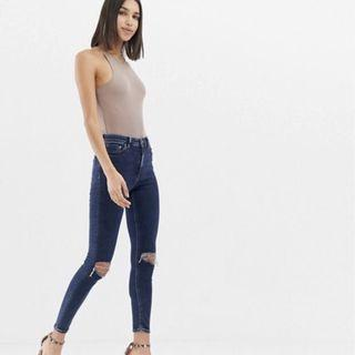 ASOS DESIGN Ridley high waist skinny jeans in deep blue wash with busted knees