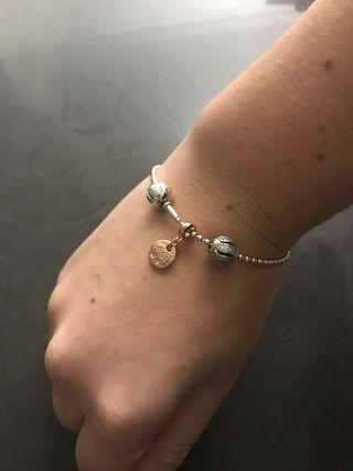 Essence bracelet with 2 charms