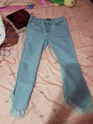 Light Blue jeans with jagged ends