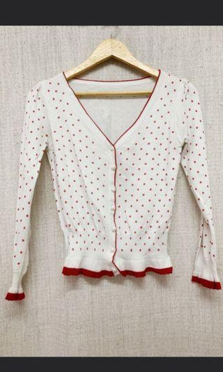 White cardigan with red polka