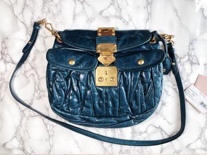 Authentic Miu miu matelasse coffer leather handbag purse in denim blue