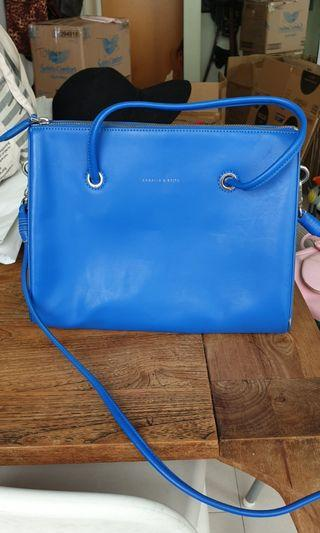 Charles and Keith cobalt blue origami triangle bag