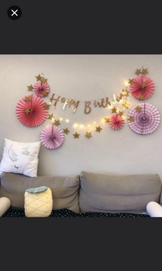 Paper Fans. Fairy lights. Happy Birthday Banner