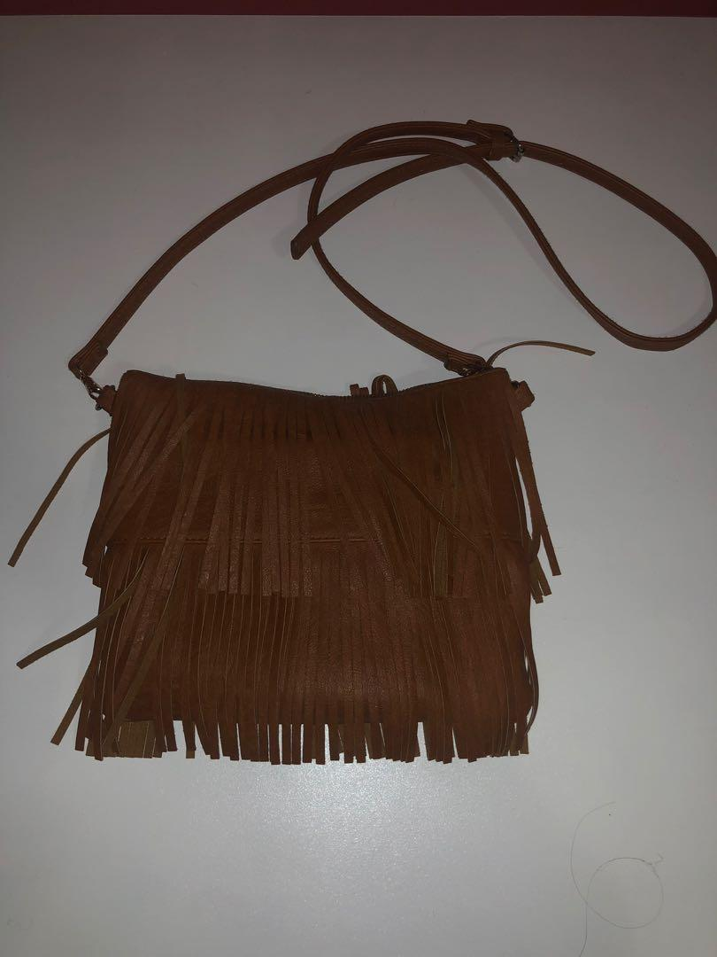 Brown frilly body bag