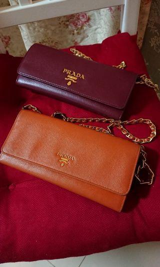 PRADA  Saffiano Wallet on chain in orange colour ( used)