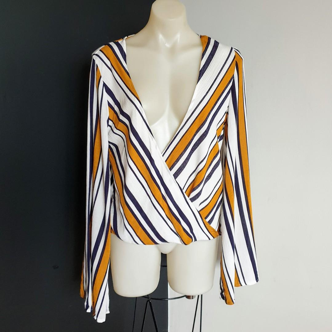 Women's size 8 (8-12) 'SUNDAYS THE LABEL' Stunning long bell sleeve overlapping blouse top- AS NEW