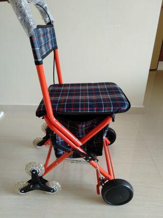 Pushcart with rest seat.