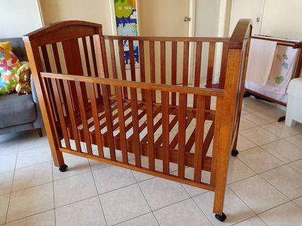 Hardly used wooden baby cot for sale