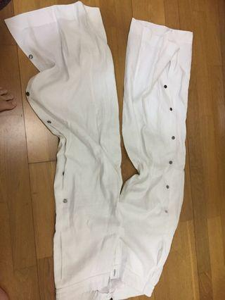 White pants with buttons on the side